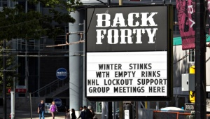 A pub near the home arena of the NHL Vancouver Canucks posts a sign in regarding the current league and players dispute in Vancouver
